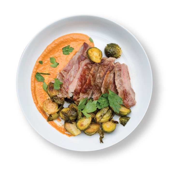 iberico with romanesco sauce and brussels sprouts