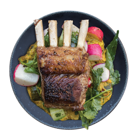 cooked lamb rack on salad