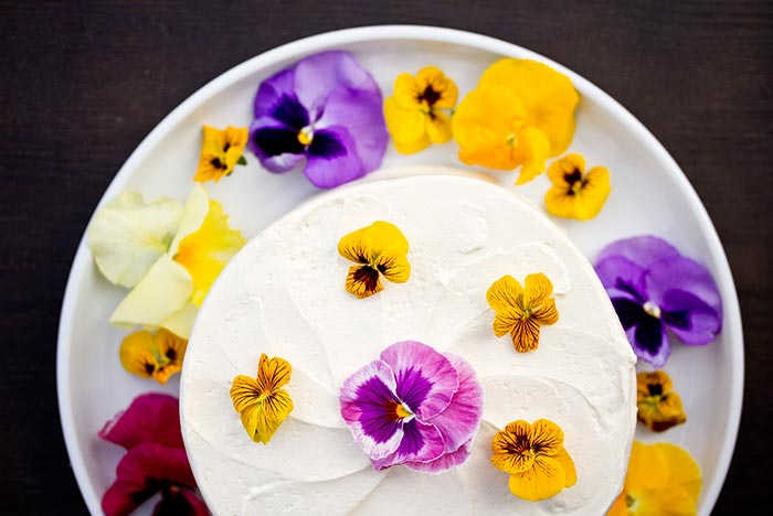 cake with edible pansies